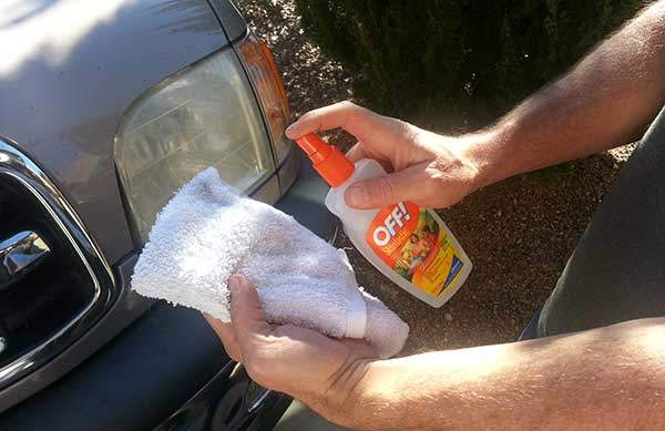 Spray on a clean cloth or paper towel